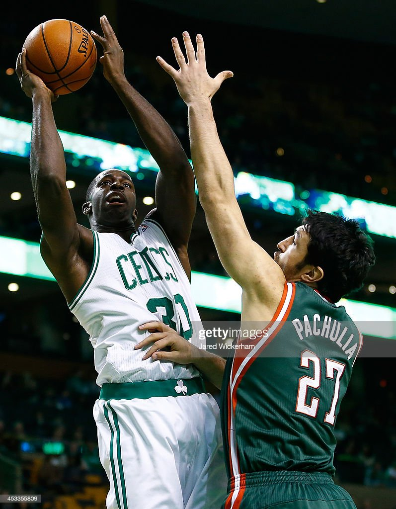 Brandon Bass #30 of the Boston Celtics takes a shot over Zaza Pachulia #27 of the Milwaukee Bucks in the first quarter during the game at TD Garden on December 3, 2013 in Boston, Massachusetts.