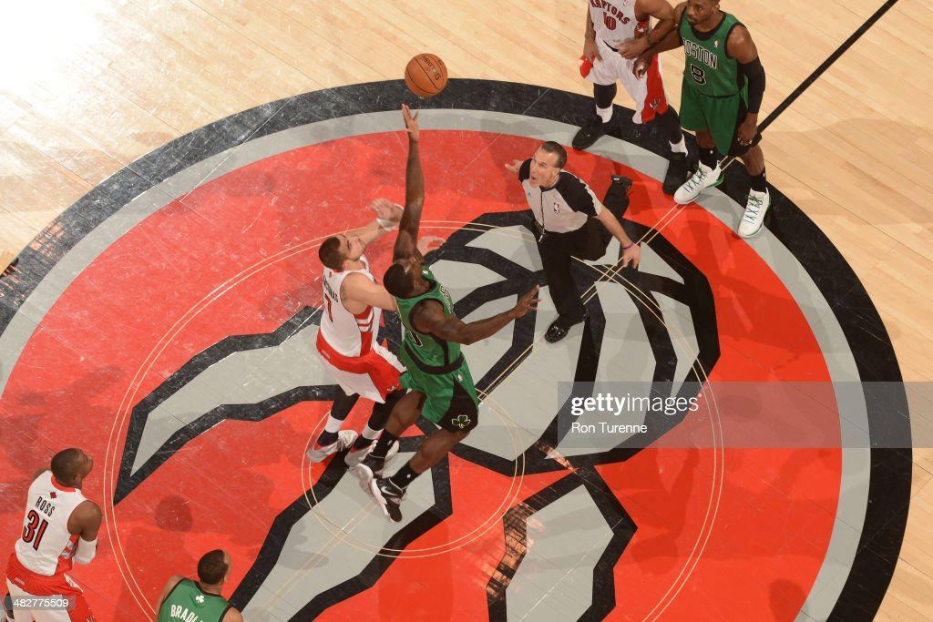 <a gi-track='captionPersonalityLinkClicked' href=/galleries/search?phrase=Brandon+Bass&family=editorial&specificpeople=233806 ng-click='$event.stopPropagation()'>Brandon Bass</a> #30 of the Boston Celtics wins the tip off to start the game against the Toronto Raptors on March 28, 2014 at the Air Canada Centre in Toronto, Ontario, Canada.