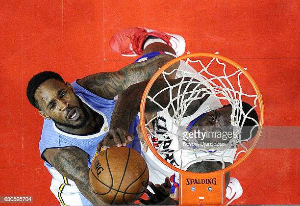 Brandon Bass of the Los Angeles Clippers and Will Barton of the Denver Nuggets battle for a rebound during the second half of the basketball game at...
