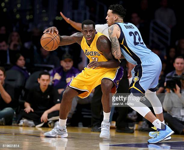 Brandon Bass of the Los Angeles Lakers backs into Matt Barnes of the Memphis Grizzlies during a game between the Los Angeles Lakers and Memphis...