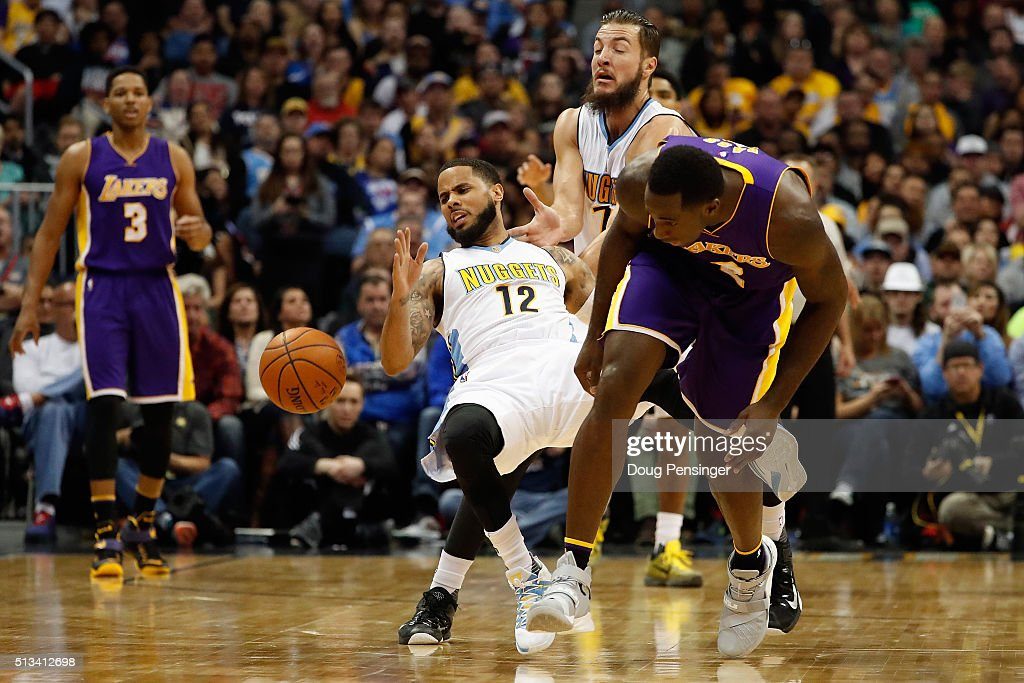 Brandon Bass #2 of the Los Angeles Lakers is called for a foul as he collides with D.J. Augustin #12 of the Denver Nuggets as they chase a loose ball at Pepsi Center on March 2, 2016 in Denver, Colorado. The Nuggets defeated the Lakers 117-107.