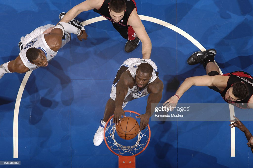 <a gi-track='captionPersonalityLinkClicked' href=/galleries/search?phrase=Brandon+Bass&family=editorial&specificpeople=233806 ng-click='$event.stopPropagation()'>Brandon Bass</a> #30 of the Orlando Magic dunks against <a gi-track='captionPersonalityLinkClicked' href=/galleries/search?phrase=Andrea+Bargnani&family=editorial&specificpeople=533014 ng-click='$event.stopPropagation()'>Andrea Bargnani</a> #7 of the Toronto Raptors on January 21, 2011 at the Amway Center in Orlando, Florida.