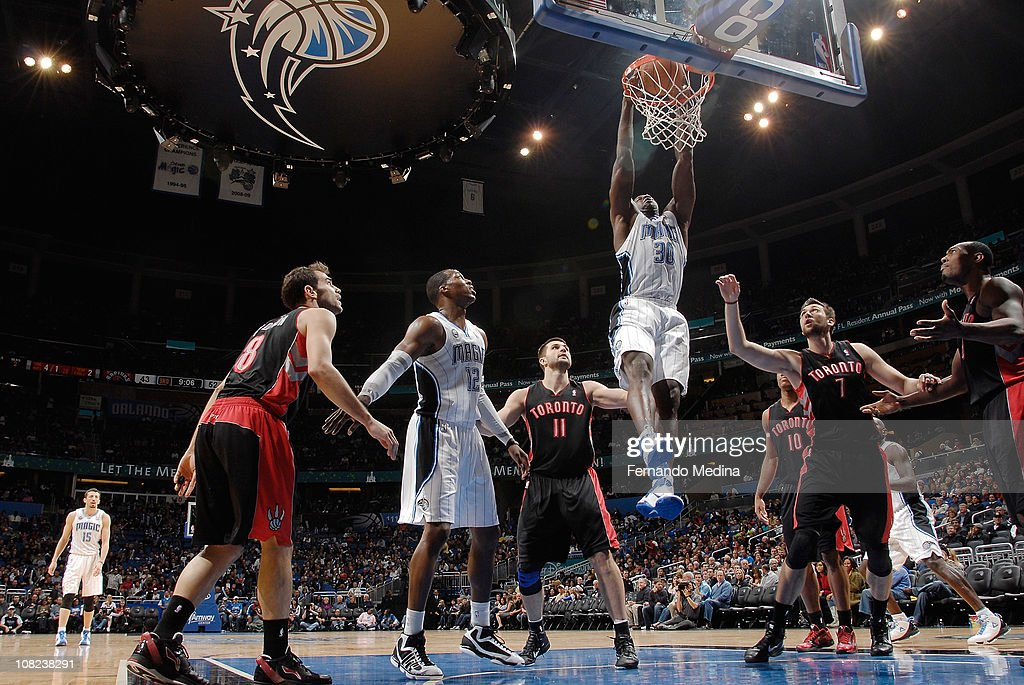 Brandon Bass #30 of the Orlando Magic dunks against the Toronto Raptors on January 21, 2011 at the Amway Center in Orlando, Florida.