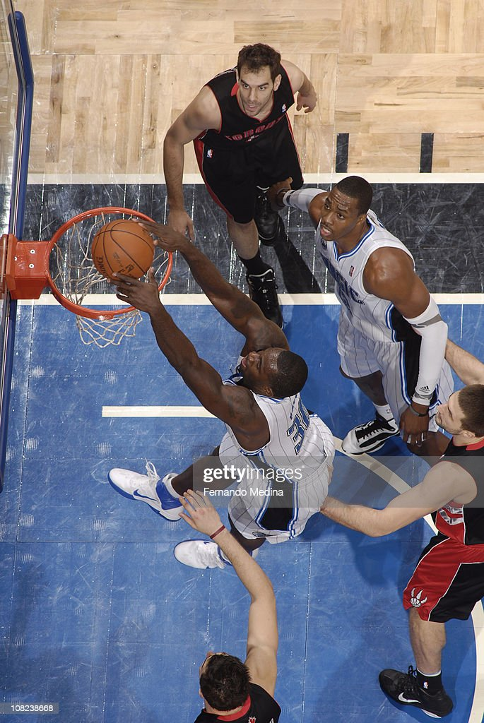 <a gi-track='captionPersonalityLinkClicked' href=/galleries/search?phrase=Brandon+Bass&family=editorial&specificpeople=233806 ng-click='$event.stopPropagation()'>Brandon Bass</a> #30 of the Orlando Magic dunks against the Toronto Raptors on January 21, 2011 at the Amway Center in Orlando, Florida.