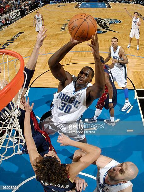 Brandon Bass of the Orlando Magic shoots against the Cleveland Cavaliers on November 11 2009 at Amway Arena in Orlando Florida NOTE TO USER User...