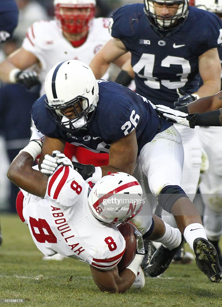 Brandon Bell #26 of the Penn State Nittany Lions tackles Ameer Abdullah #8 of the Nebraska Cornhuskers during the game on November 23, 2013 at Beaver Stadium in State College, Pennsylvania.