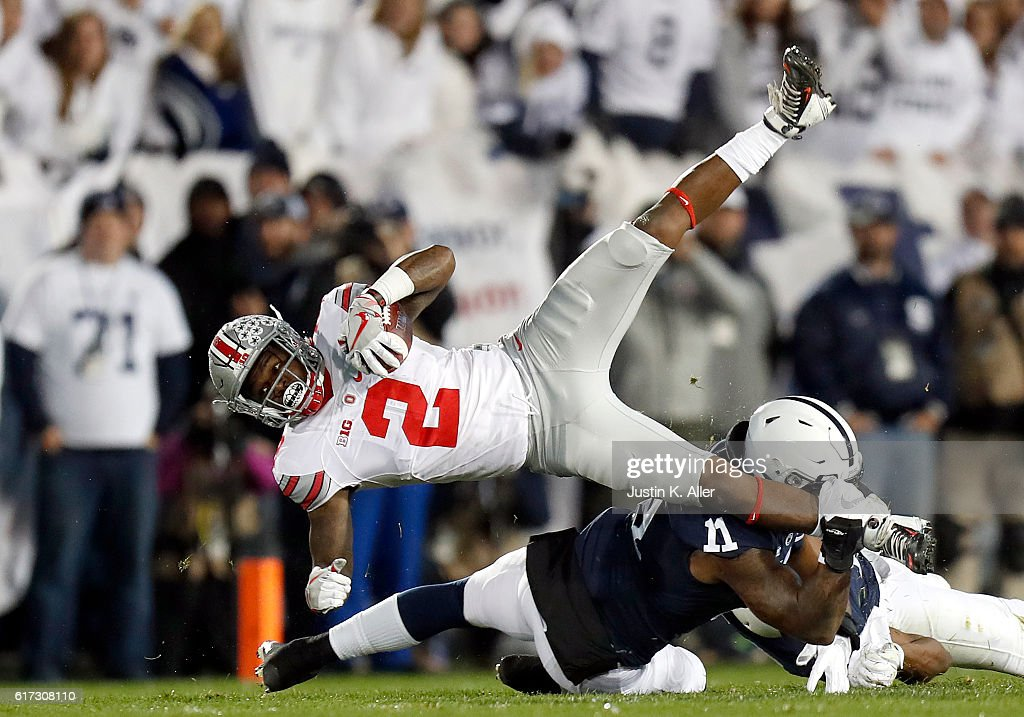 Brandon Bell #11 of the Penn State Nittany Lions tackles Dontre Wilson #2 of the Ohio State Buckeyes in the first half during the game on October 22, 2016 at Beaver Stadium in State College, Pennsylvania.