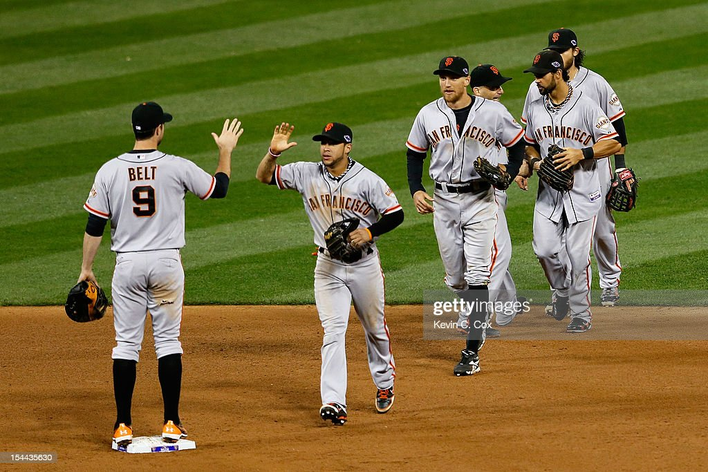 <a gi-track='captionPersonalityLinkClicked' href=/galleries/search?phrase=Brandon+Belt&family=editorial&specificpeople=7513394 ng-click='$event.stopPropagation()'>Brandon Belt</a> #9 and <a gi-track='captionPersonalityLinkClicked' href=/galleries/search?phrase=Gregor+Blanco&family=editorial&specificpeople=4137600 ng-click='$event.stopPropagation()'>Gregor Blanco</a> #7 of the San Francisco Giants celebrate the Giants 5-0 victory in Game Five of the National League Championship Series at Busch Stadium on October 19, 2012 in St Louis, Missouri.