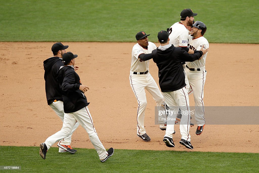 <a gi-track='captionPersonalityLinkClicked' href=/galleries/search?phrase=Brandon+Belt&family=editorial&specificpeople=7513394 ng-click='$event.stopPropagation()'>Brandon Belt</a> #9 and Juan Perez #2 of the San Francisco Giants celebrate the 5-4 10th inning victory against the St. Louis Cardinals during Game Three of the National League Championship Series at AT&T Park on October 14, 2014 in San Francisco, California.
