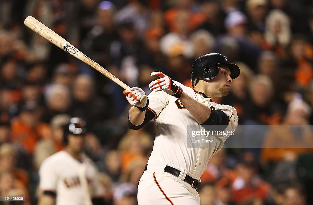 Brandon Belt #9 hits an RBI single scoring Marco Scutaro #19 of the San Francisco Giants in the fourth inning of Game One of the National League Championship Series against the St. Louis Cardinals at AT&T Park on October 14, 2012 in San Francisco, California.