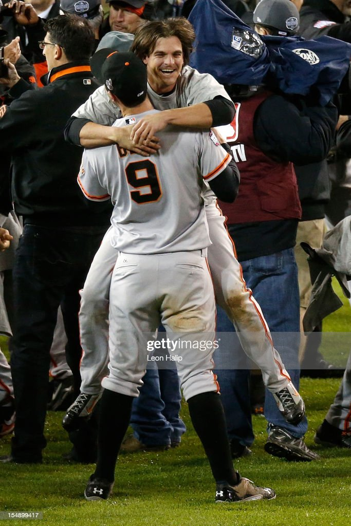 Brandon Belt #9 hugs Ryan Theriot #5 of the San Francisco Giants after defeating the Detroit Tigers to win Game Four of the Major League Baseball World Series at Comerica Park on October 28, 2012 in Detroit, Michigan. The San Francisco Giants defeated the Detroit Tigers 4-3 in the tenth inning to win the World Series in 4 straight games.