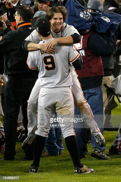 Brandon Belt hugs Ryan Theriot of the San Francisco Giants after defeating the Detroit Tigers to win Game Four of the Major League Baseball World...