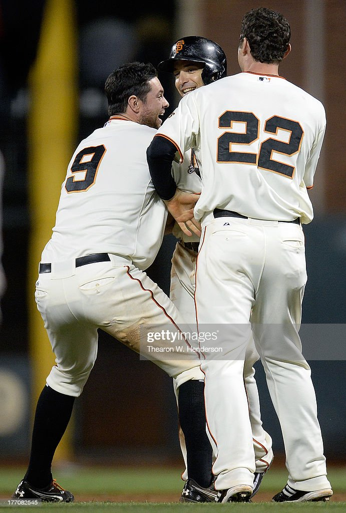 <a gi-track='captionPersonalityLinkClicked' href=/galleries/search?phrase=Brandon+Belt&family=editorial&specificpeople=7513394 ng-click='$event.stopPropagation()'>Brandon Belt</a> #9, <a gi-track='captionPersonalityLinkClicked' href=/galleries/search?phrase=Marco+Scutaro&family=editorial&specificpeople=239523 ng-click='$event.stopPropagation()'>Marco Scutaro</a> #19 and Roger Kieschnick #22 celebrates after Scutaro walked on four pitches with the bases loaded to defeat the Boston Red Sox 3-2 in the bottom of the ninth inning at AT&T Park on August 20, 2013 in San Francisco, California.