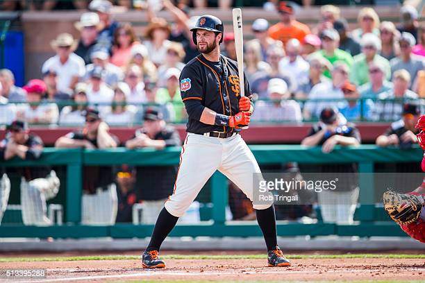 Brandon Belt of the San Francisco Giants bats during a spring training game against the Los Angeles Angels of Anaheim at Scottsdale Stadium on March...