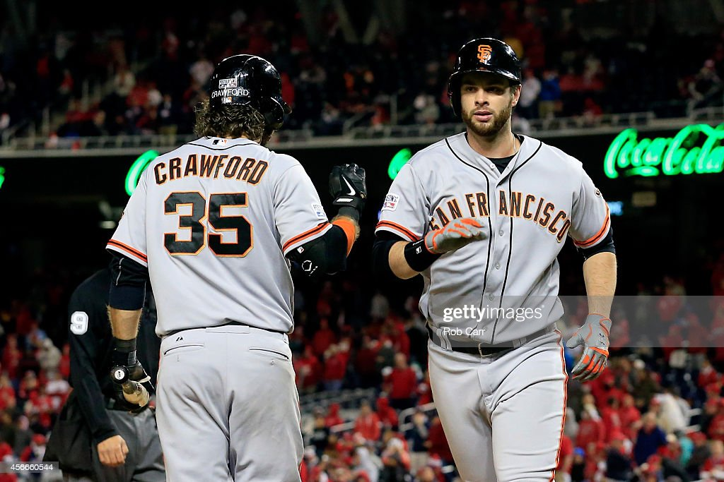 <a gi-track='captionPersonalityLinkClicked' href=/galleries/search?phrase=Brandon+Belt&family=editorial&specificpeople=7513394 ng-click='$event.stopPropagation()'>Brandon Belt</a> #9 of the San Francisco Giants celebrates with his teammate <a gi-track='captionPersonalityLinkClicked' href=/galleries/search?phrase=Brandon+Crawford&family=editorial&specificpeople=5580312 ng-click='$event.stopPropagation()'>Brandon Crawford</a> #35 after hitting a solo home run to right field in the eighteenth inning against Tanner Roark #57 of the Washington Nationals during Game Two of the National League Division Series at Nationals Park on October 4, 2014 in Washington, DC.