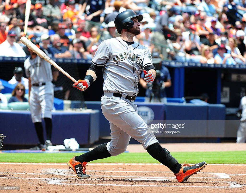 <a gi-track='captionPersonalityLinkClicked' href=/galleries/search?phrase=Brandon+Belt&family=editorial&specificpeople=7513394 ng-click='$event.stopPropagation()'>Brandon Belt</a> #9 of the San Francisco Giants hit a second inning solo home run against the Atlanta Braves at Turner Field on May 30, 2016 in Atlanta, Georgia.