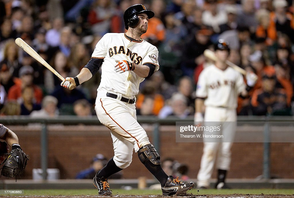 <a gi-track='captionPersonalityLinkClicked' href=/galleries/search?phrase=Brandon+Belt&family=editorial&specificpeople=7513394 ng-click='$event.stopPropagation()'>Brandon Belt</a> #9 of the San Francisco Giants hits a double in the sixth inning against the Boston Red Sox at AT&T Park on August 20, 2013 in San Francisco, California.