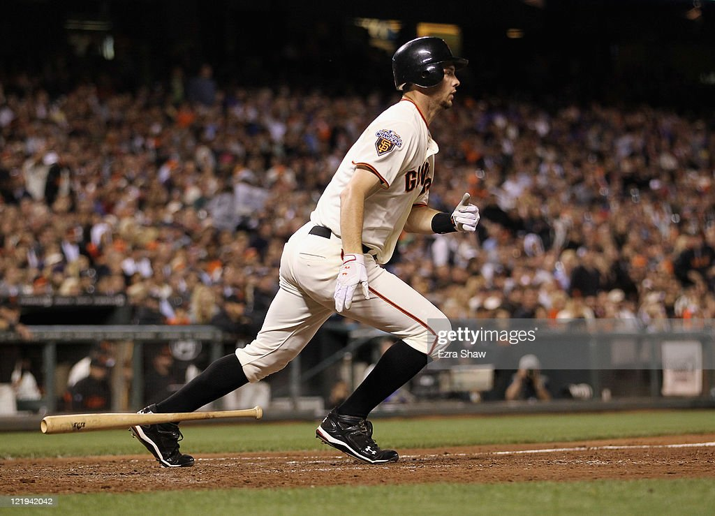 <a gi-track='captionPersonalityLinkClicked' href=/galleries/search?phrase=Brandon+Belt&family=editorial&specificpeople=7513394 ng-click='$event.stopPropagation()'>Brandon Belt</a> #9 of the San Francisco Giants hits a fielder's choice that scored two runs in the sixth inning of their game against the San Diego Padres at AT&T Park on August 23, 2011 in San Francisco, California.