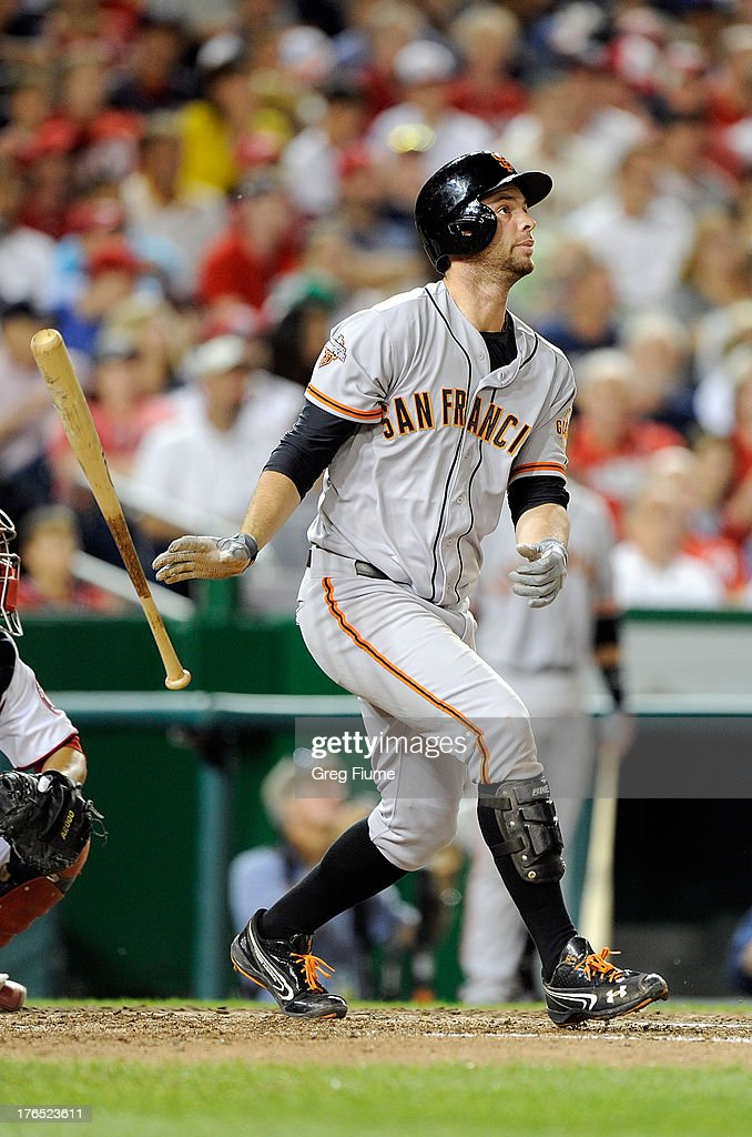 <a gi-track='captionPersonalityLinkClicked' href=/galleries/search?phrase=Brandon+Belt&family=editorial&specificpeople=7513394 ng-click='$event.stopPropagation()'>Brandon Belt</a> #9 of the San Francisco Giants hits a home run in the eighth inning against the Washington Nationals at Nationals Park on August 14, 2013 in Washington, DC.