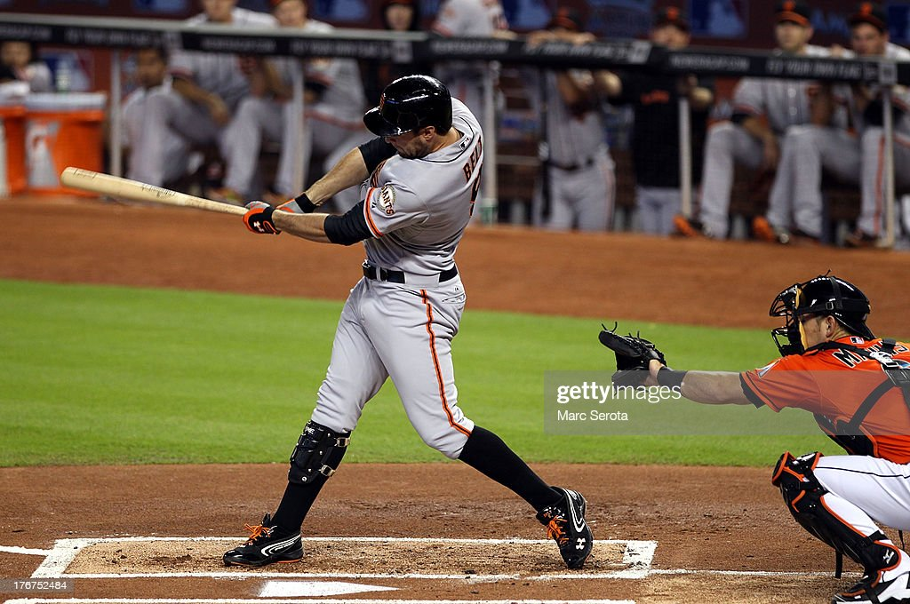 <a gi-track='captionPersonalityLinkClicked' href=/galleries/search?phrase=Brandon+Belt&family=editorial&specificpeople=7513394 ng-click='$event.stopPropagation()'>Brandon Belt</a> #9 of the San Francisco Giants hits a single against the Miami Marlins at Marlins Park on August 18, 2013 in Miami, Florida.
