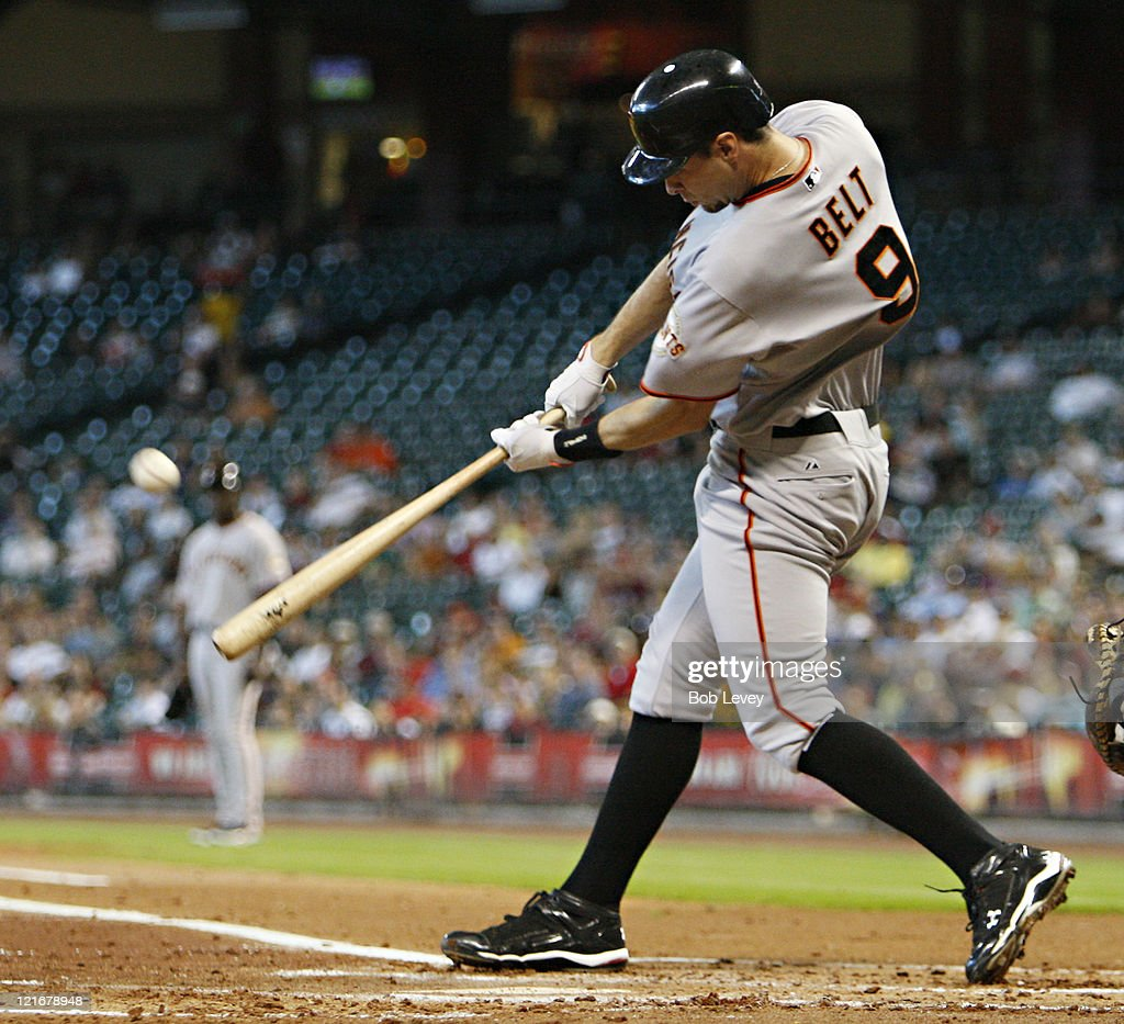 <a gi-track='captionPersonalityLinkClicked' href=/galleries/search?phrase=Brandon+Belt&family=editorial&specificpeople=7513394 ng-click='$event.stopPropagation()'>Brandon Belt</a> #9 of the San Francisco Giants hits a three run home run to right field in the first inning against the Houston Astros at Minute Maid Park on August 21, 2011 in Houston, Texas.