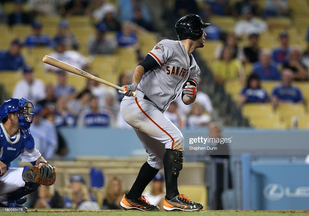 <a gi-track='captionPersonalityLinkClicked' href=/galleries/search?phrase=Brandon+Belt&family=editorial&specificpeople=7513394 ng-click='$event.stopPropagation()'>Brandon Belt</a> #9 of the San Francisco Giants hits a two run double in the eighth inning against the Los Angeles Dodgers at Dodger Stadium on September 14, 2013 in Los Angeles, California.