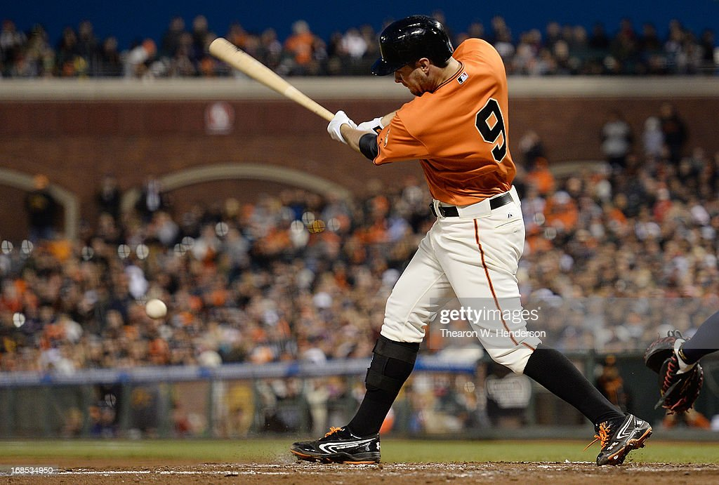 <a gi-track='captionPersonalityLinkClicked' href=/galleries/search?phrase=Brandon+Belt&family=editorial&specificpeople=7513394 ng-click='$event.stopPropagation()'>Brandon Belt</a> #9 of the San Francisco Giants hits an RBI double down the right field line scoring Buster Posey #28 against the Atlanta Braves in the fourth inning at AT&T Park on May 10, 2013 in San Francisco, California.