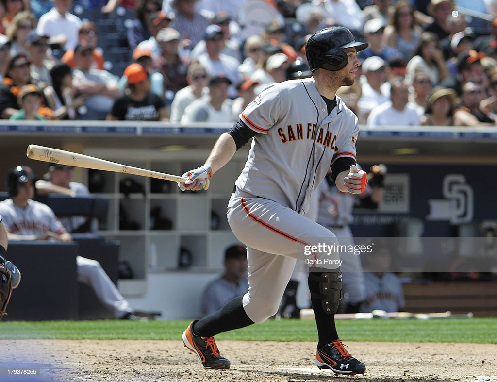 <a gi-track='captionPersonalityLinkClicked' href=/galleries/search?phrase=Brandon+Belt&family=editorial&specificpeople=7513394 ng-click='$event.stopPropagation()'>Brandon Belt</a> #9 of the San Francisco Giants hits an RBI double during the fifth inning of a baseball game against the San Diego Padres at Petco Park on September 2, 2013 in San Diego, California.
