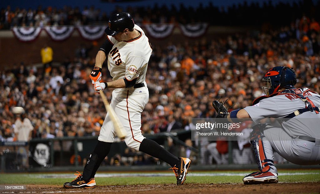 Brandon Belt #9 of the San Francisco Giants hits an RBI single scoring Marco Scutaro #19 in the fourth during Game One of the National League Championship Series at AT&T Park on October 14, 2012 in San Francisco, California.