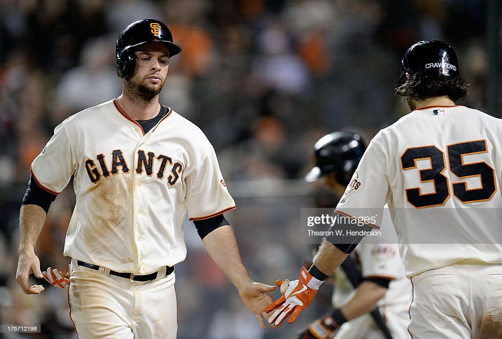<a gi-track='captionPersonalityLinkClicked' href=/galleries/search?phrase=Brandon+Belt&family=editorial&specificpeople=7513394 ng-click='$event.stopPropagation()'>Brandon Belt</a> #9 of the San Francisco Giants is congratulated by <a gi-track='captionPersonalityLinkClicked' href=/galleries/search?phrase=Brandon+Crawford&family=editorial&specificpeople=5580312 ng-click='$event.stopPropagation()'>Brandon Crawford</a> after Belt scored in the seventh inning against the Milwaukee Brewers at AT&T Park on August 6, 2013 in San Francisco, California.
