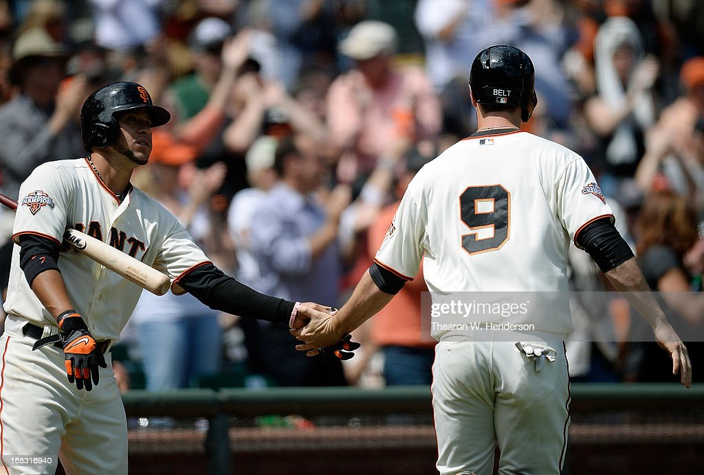 <a gi-track='captionPersonalityLinkClicked' href=/galleries/search?phrase=Brandon+Belt&family=editorial&specificpeople=7513394 ng-click='$event.stopPropagation()'>Brandon Belt</a> #9 of the San Francisco Giants is congratulated by <a gi-track='captionPersonalityLinkClicked' href=/galleries/search?phrase=Gregor+Blanco&family=editorial&specificpeople=4137600 ng-click='$event.stopPropagation()'>Gregor Blanco</a> #7 after Belt scored on an RBI single from pitcher Barry Zito #75 (not pictured) against the Philadelphia Phillies in the sixth inning at AT&T Park on May 8, 2013 in San Francisco, California.