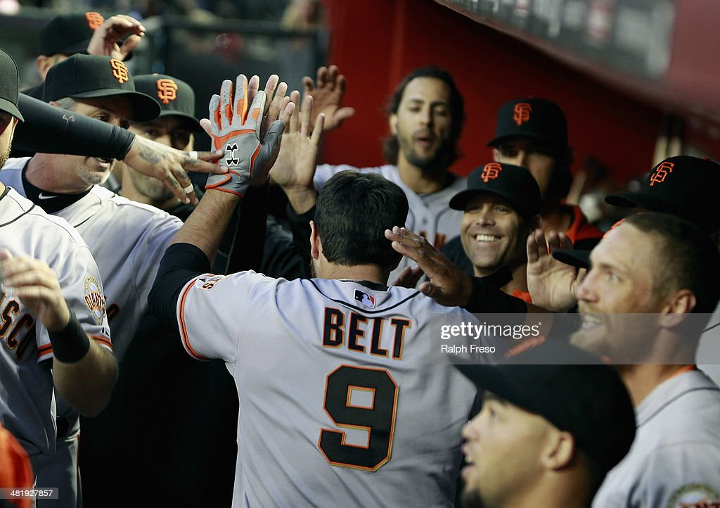 <a gi-track='captionPersonalityLinkClicked' href=/galleries/search?phrase=Brandon+Belt&family=editorial&specificpeople=7513394 ng-click='$event.stopPropagation()'>Brandon Belt</a> #9 of the San Francisco Giants is congratulated by teammates following his three-run home run against the Arizona Diamondbacks during the first inning of a MLB game at Chase Field on April 1, 2014 in Phoenix, Arizona.