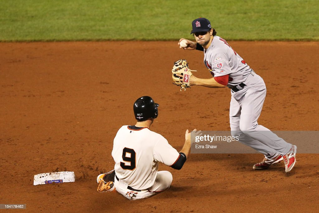 Brandon Belt #9 of the San Francisco Giants is forced out at seconf base by Pete Kozma #38 of the St. Louis Cardinals on a ground ball hit by Gregor Blanco #7 during Game Two of the National League Championship Series at AT&T Park on October 15, 2012 in San Francisco, California.