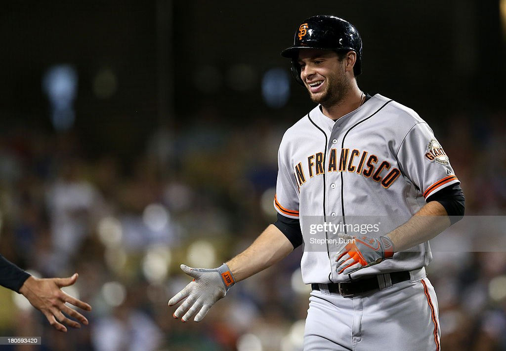 <a gi-track='captionPersonalityLinkClicked' href=/galleries/search?phrase=Brandon+Belt&family=editorial&specificpeople=7513394 ng-click='$event.stopPropagation()'>Brandon Belt</a> #9 of the San Francisco Giants is greeted by a teammate as he returns to the dugout after hitting a two run home run in the seventh inning against the Los Angeles Dodgers at Dodger Stadium on September 14, 2013 in Los Angeles, California.