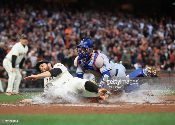 Brandon Belt of the San Francisco Giants is tagged out by Yasmani Grandal of the Los Angeles Dodgers in the first inning at ATT Park on April 24 2017...