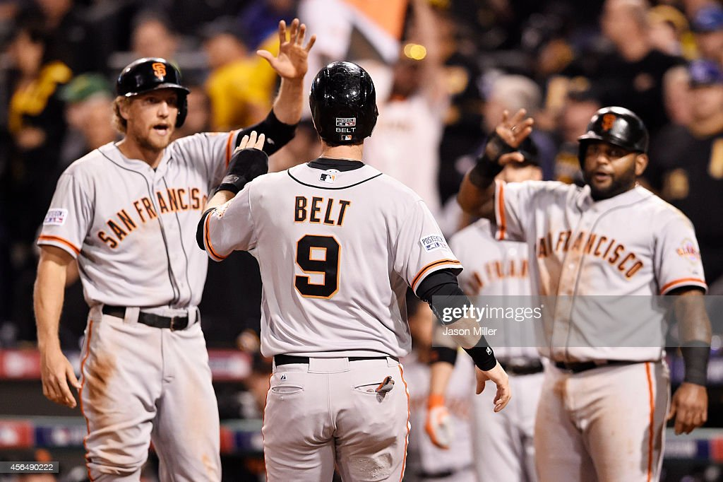 <a gi-track='captionPersonalityLinkClicked' href=/galleries/search?phrase=Brandon+Belt&family=editorial&specificpeople=7513394 ng-click='$event.stopPropagation()'>Brandon Belt</a> #9 of the San Francisco Giants is welcomed home as he scores on a four-run home run hit by Brandon Crawford #35 in the fourth inning against the Pittsburgh Pirates during the National League Wild Card game at PNC Park on October 1, 2014 in Pittsburgh, Pennsylvania.