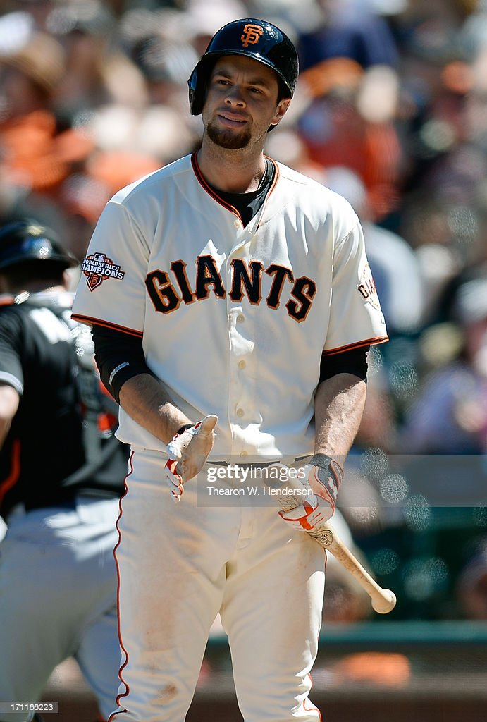 <a gi-track='captionPersonalityLinkClicked' href=/galleries/search?phrase=Brandon+Belt&family=editorial&specificpeople=7513394 ng-click='$event.stopPropagation()'>Brandon Belt</a> #9 of the San Francisco Giants reacts after being called out on strike for the third out of the ninth inning against the Miami Marlins at AT&T Park on June 22, 2013 in San Francisco, California.