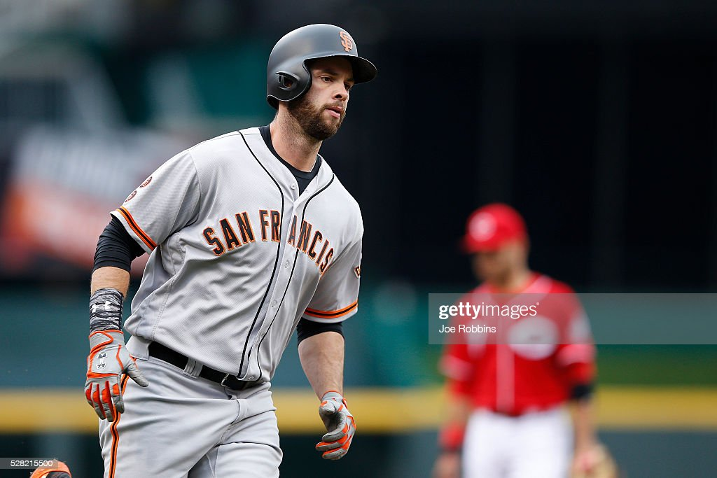 <a gi-track='captionPersonalityLinkClicked' href=/galleries/search?phrase=Brandon+Belt&family=editorial&specificpeople=7513394 ng-click='$event.stopPropagation()'>Brandon Belt</a> #9 of the San Francisco Giants rounds the bases after a solo home run against the Cincinnati Reds in the second inning of the game at Great American Ball Park on May 4, 2016 in Cincinnati, Ohio.