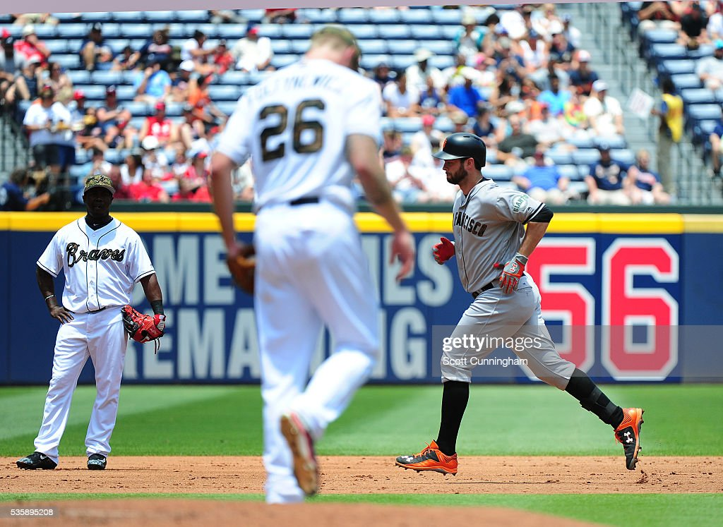 <a gi-track='captionPersonalityLinkClicked' href=/galleries/search?phrase=Brandon+Belt&family=editorial&specificpeople=7513394 ng-click='$event.stopPropagation()'>Brandon Belt</a> #9 of the San Francisco Giants rounds the bases after hitting a second inning solo home run against Mike Foltynewicz #26 of the Atlanta Braves at Turner Field on May 30, 2016 in Atlanta, Georgia.