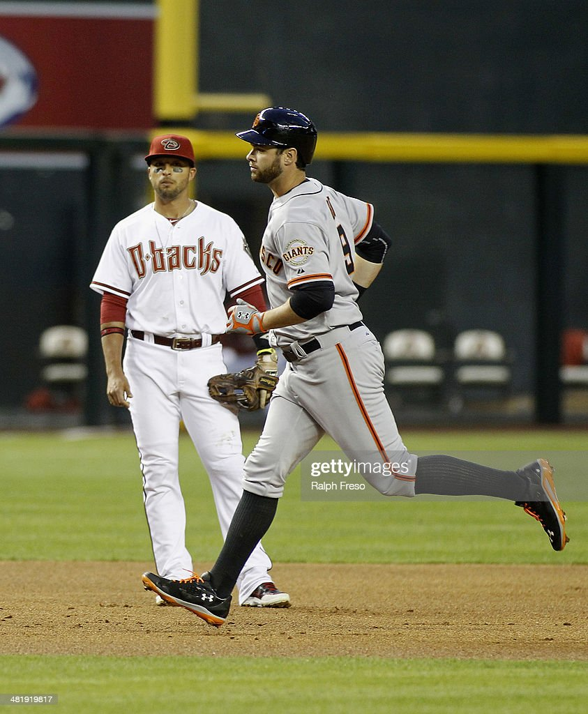 <a gi-track='captionPersonalityLinkClicked' href=/galleries/search?phrase=Brandon+Belt&family=editorial&specificpeople=7513394 ng-click='$event.stopPropagation()'>Brandon Belt</a> #9 of the San Francisco Giants runs past <a gi-track='captionPersonalityLinkClicked' href=/galleries/search?phrase=Martin+Prado&family=editorial&specificpeople=620159 ng-click='$event.stopPropagation()'>Martin Prado</a> #14 of the Arizona Diamondbacks on his three-run home run during the first inning of a MLB game at Chase Field on April 1, 2014 in Phoenix, Arizona.