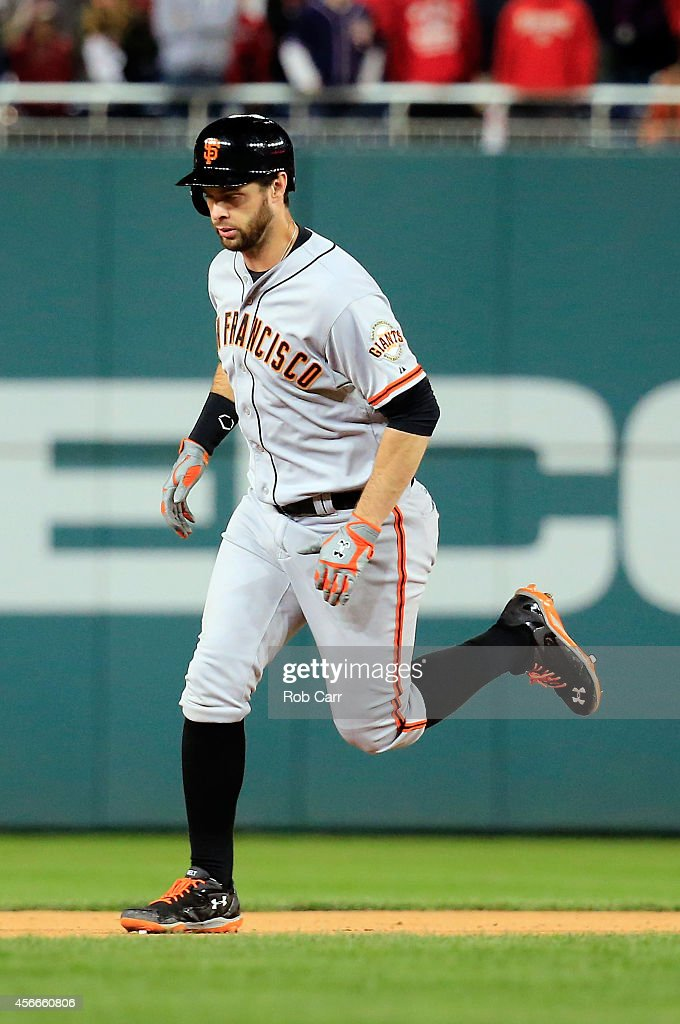 <a gi-track='captionPersonalityLinkClicked' href=/galleries/search?phrase=Brandon+Belt&family=editorial&specificpeople=7513394 ng-click='$event.stopPropagation()'>Brandon Belt</a> #9 of the San Francisco Giants runs the bases after hitting a solo home run to right field in the eighteenth inning against Tanner Roark #57 of the Washington Nationals during Game Two of the National League Division Series at Nationals Park on October 4, 2014 in Washington, DC.