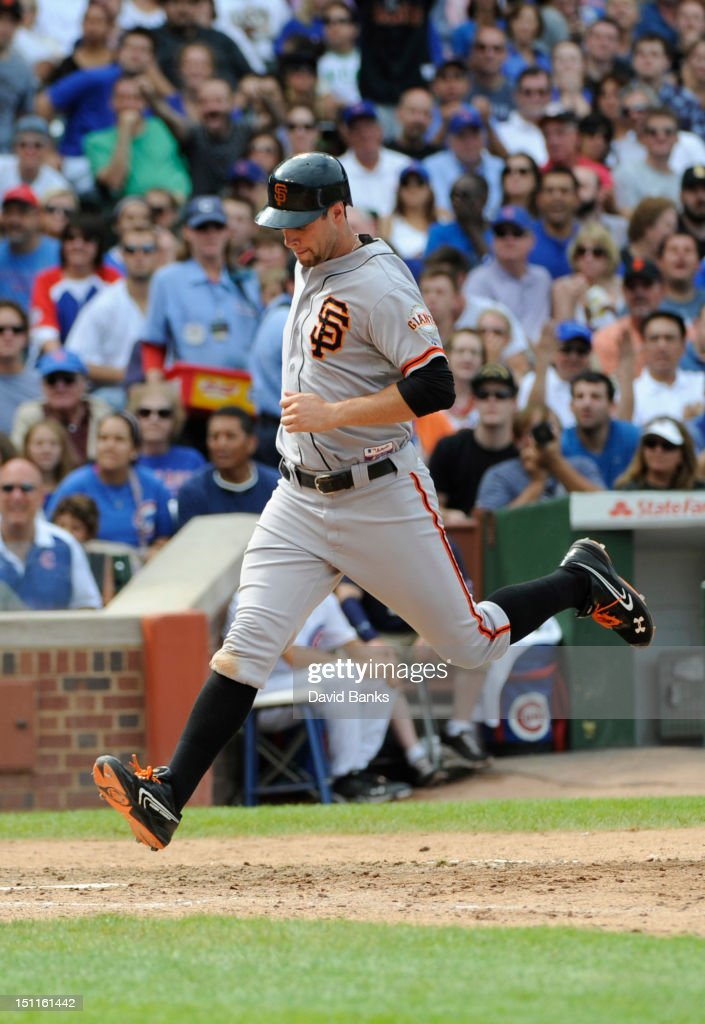 <a gi-track='captionPersonalityLinkClicked' href=/galleries/search?phrase=Brandon+Belt&family=editorial&specificpeople=7513394 ng-click='$event.stopPropagation()'>Brandon Belt</a> #9 of the San Francisco Giants scores a run in the sixth inning against the Chicago Cubs on September 02 2012 at Wrigley Field in Chicago, Illinois.