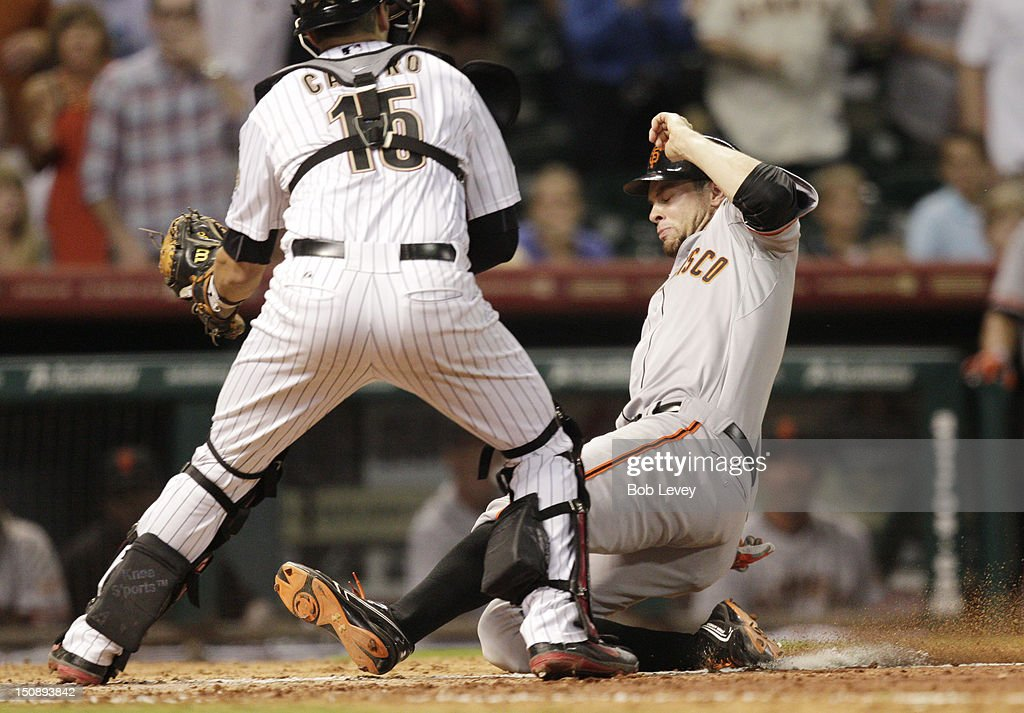 <a gi-track='captionPersonalityLinkClicked' href=/galleries/search?phrase=Brandon+Belt&family=editorial&specificpeople=7513394 ng-click='$event.stopPropagation()'>Brandon Belt</a> #9 of the San Francisco Giants scores on a double by Joaquin Arias #13 of the San Francisco Giants in the ninth inning against the Houston Astros at Minute Maid Park on August 28, 2012 in Houston, Texas.