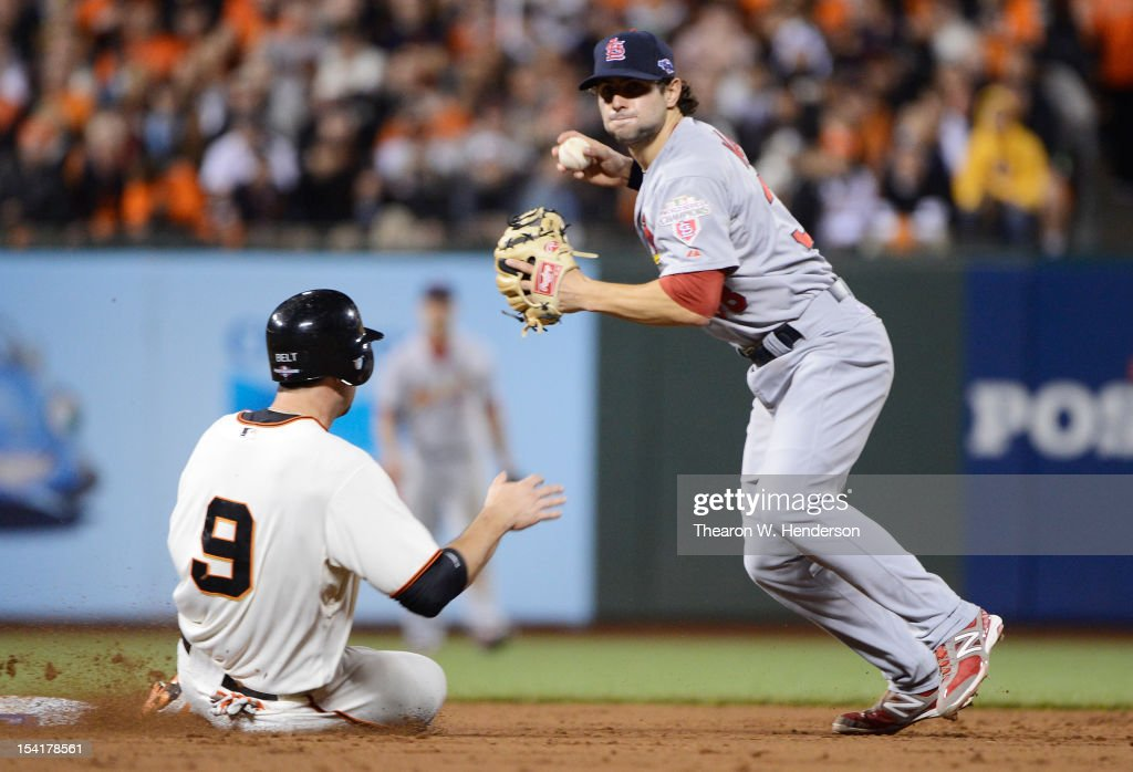 Brandon Belt #9 of the San Francisco Giants slides into second base stopping a double play attempt by Pete Kozma #38 of the St. Louis Cardinals during Game Two of the National League Championship Series at AT&T Park on October 15, 2012 in San Francisco, California.