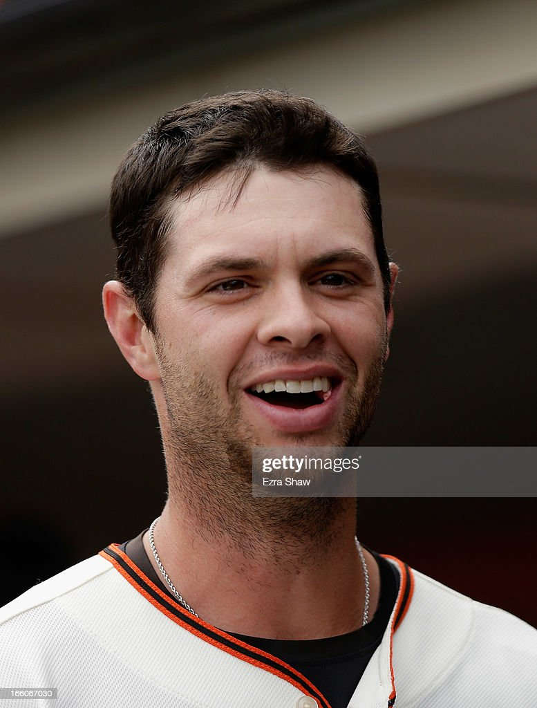 <a gi-track='captionPersonalityLinkClicked' href=/galleries/search?phrase=Brandon+Belt&family=editorial&specificpeople=7513394 ng-click='$event.stopPropagation()'>Brandon Belt</a> #9 of the San Francisco Giants stands in the dugout during their game against the St. Louis Cardinals at AT&T Park on April 6, 2013 in San Francisco, California.