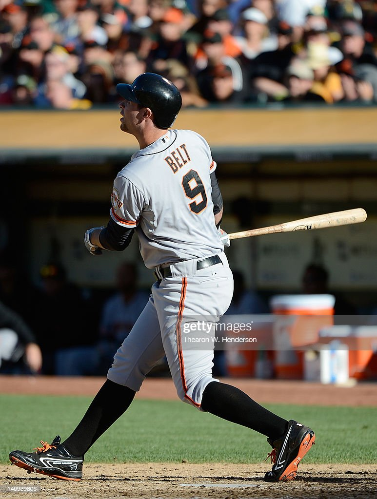 <a gi-track='captionPersonalityLinkClicked' href=/galleries/search?phrase=Brandon+Belt&family=editorial&specificpeople=7513394 ng-click='$event.stopPropagation()'>Brandon Belt</a> #9 of the San Francisco Giants swings and watches the flight of his ball as he hits a two-run home run in the six inning against the Oakland Athletics at O.co Coliseum on June 23, 2012 in Oakland, California.
