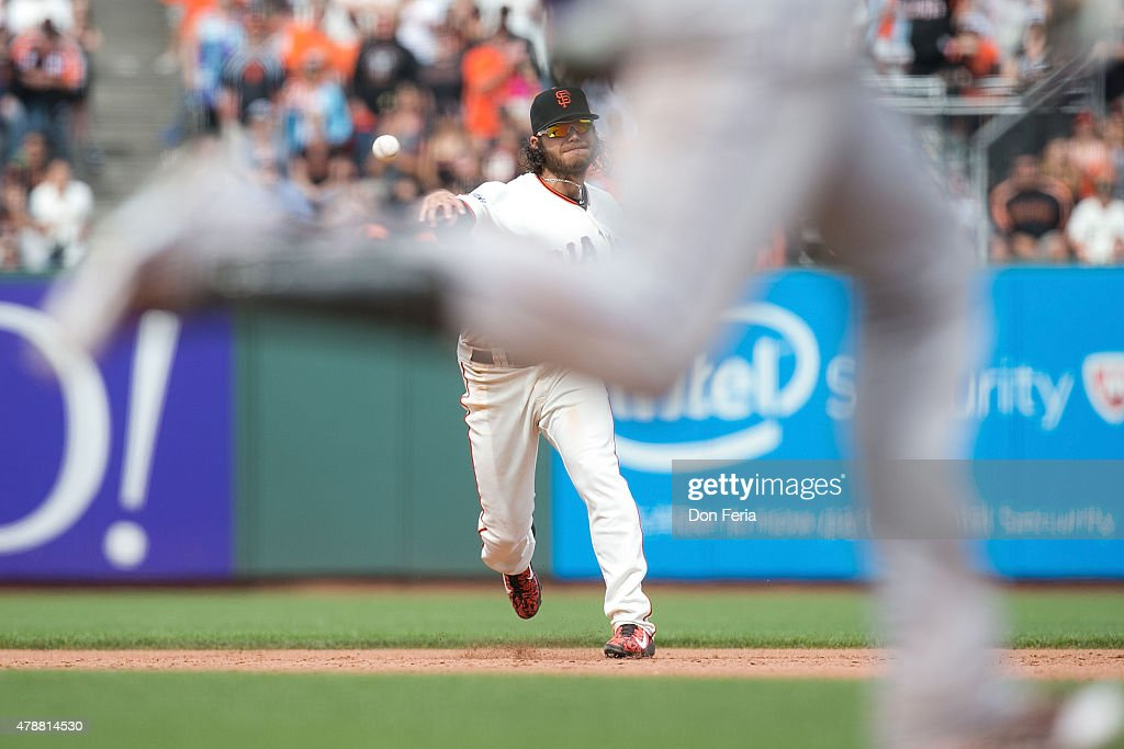 Brandon Belt #9 of the San Francisco Giants throws to first base for the game-ending out in the top of the ninth inning against the Colorado Rockies at AT&T Park on June 27, 2015 in San Francisco, California. The Giants won the second game of the series 7-5.