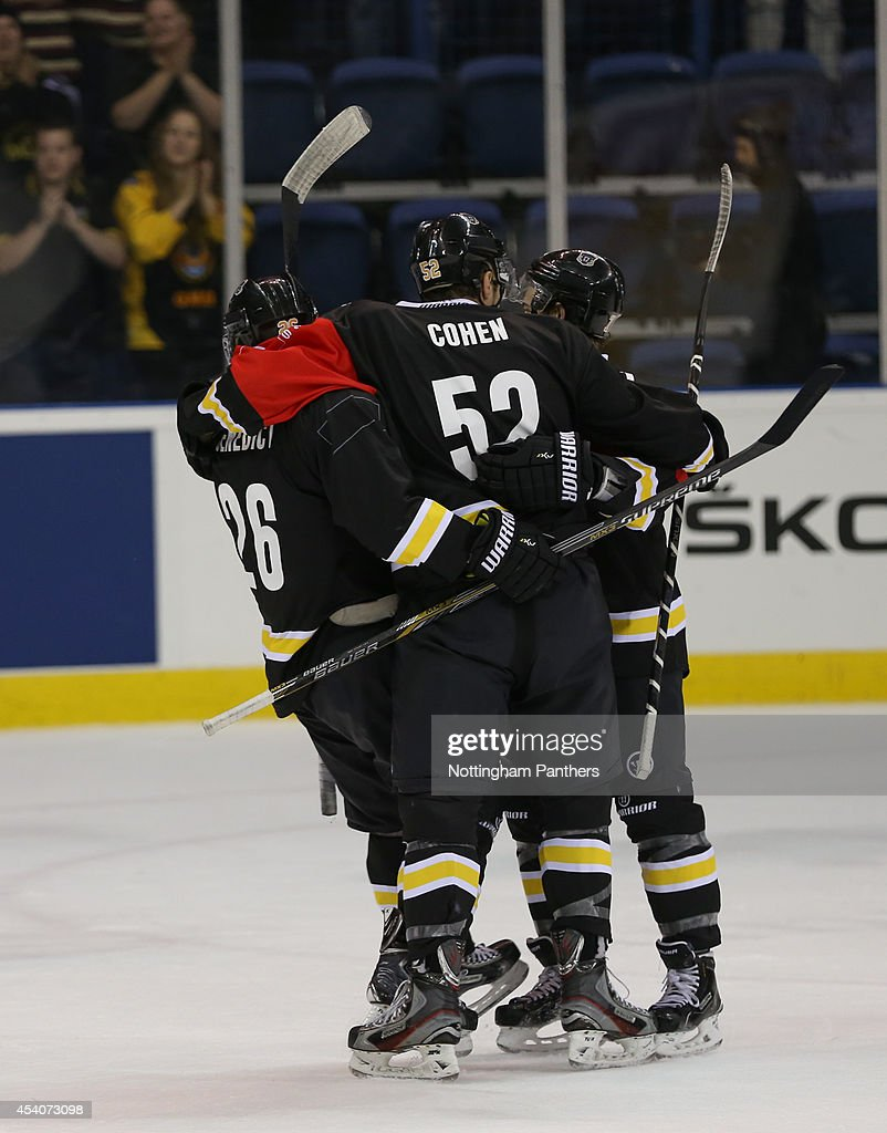 Brandon Benedict #26 of Nottingham Panthers celebrates his goal with team mates during the Champions Hockey League group stage game between Nottingham Panthers and Lulea Hockeyat at the National Ice Centre on August 24, 2014 in Nottingham, England.