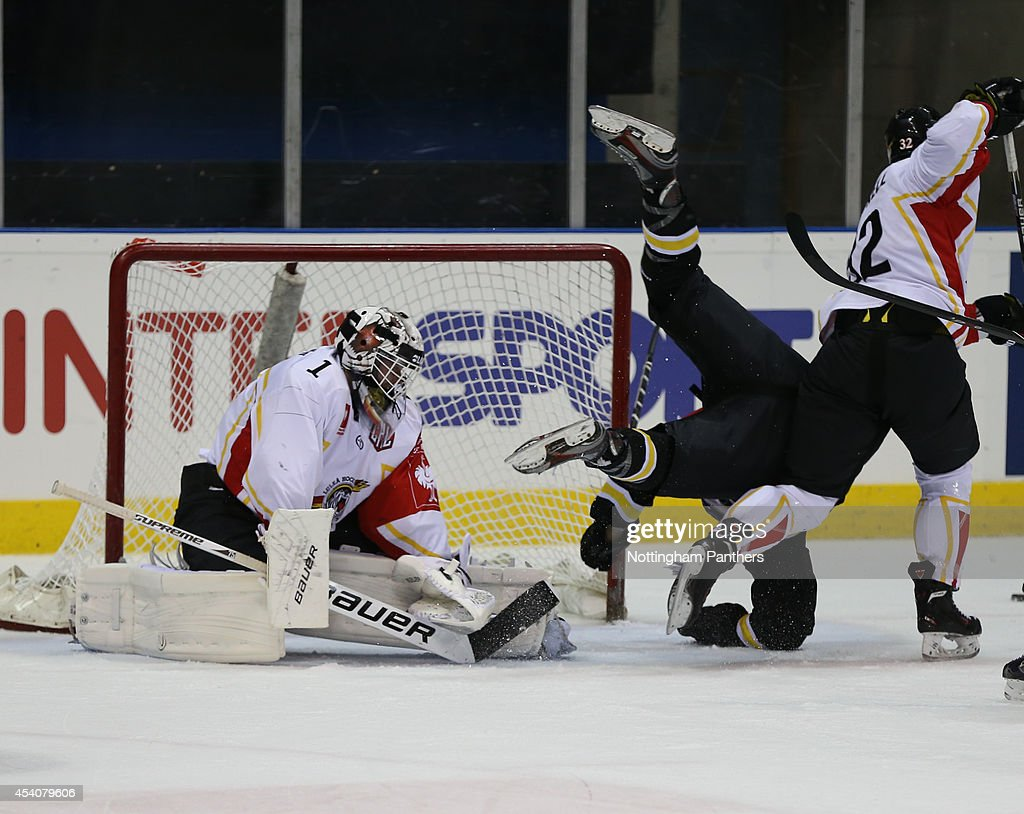 Brandon Benedict #26 of Nottingham Panthers is fouled by a Lulea player during the Champions Hockey League group stage game between Nottingham Panthers and Lulea Hockeyat at the National Ice Centre on August 24, 2014 in Nottingham, England.
