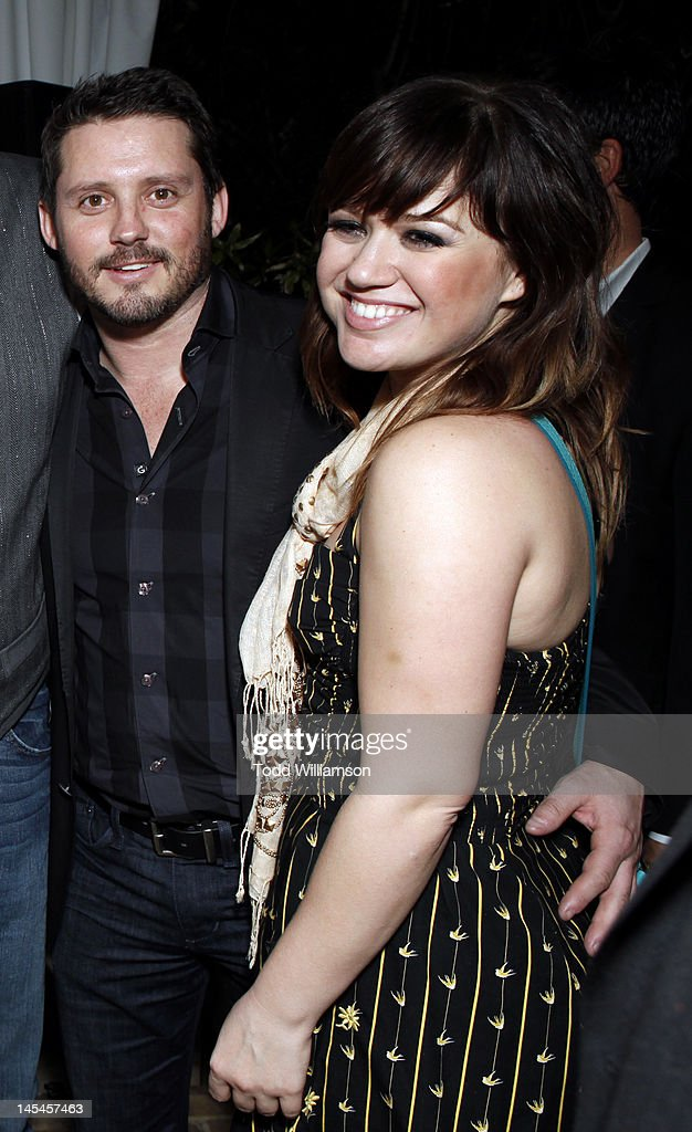 Brandon Blackstock and Kelly Clarkson attend Warner Music Group Grammy Celebration hosted by InStyle at Chateau Marmont on February 12, 2012 in Los Angeles, California.